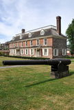 Yonkers, NY: 1693 Philipsburg Manor. An elongated 19th century canon from the 1861-65 American Civil War sits on the lawn at 1693 colonial-era Philipsburg Manor Stock Image