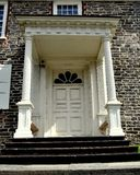 Yonkers, NY: Georgian Entrance to Philipse Manor. Yonkers, New York - August 6, 2012:  The fieldstone south front with Georgian doorway and columned portico at Stock Photography