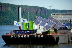 Yonkers, NY: The Science Barge. The educational Science Barge with its windmills, solar panels, and green houses docked on the Hudson River in Yonkers, New York royalty free stock images