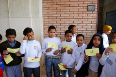 Yonng boys playing words game at charity event. Group of boys playing words game at school, holding up Arabic words written on cardboard at charity event, at a Stock Photography