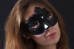Yonug woman mysterious mask Stock Image