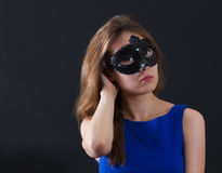 Yonug woman venetian mask Royalty Free Stock Photos