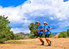 Yoon & Moon Lee run the course of stage 1. Buena Vista, CO - Aug 21: Yoon and Moon Lee team Happy Runners on the course during stage 1 of the Gore-Tex Royalty Free Stock Photos