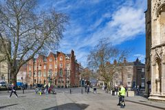 Dean Court, historic building built by red brown bricks located in front of York Minster in the city of York, England, UK. York, England - April 2018: Dean Court royalty free stock photo