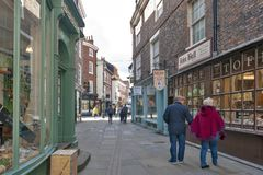 Shops along Minster Gates street near York Minster in historic district of City of York, England, UK stock photos