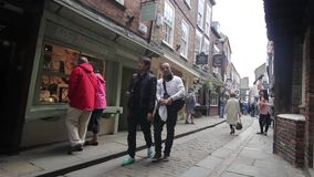 YORK, ENGLAND, JUNE 22 2015: visitors walking along old, historical streets. enjoying summer holidays stock footage