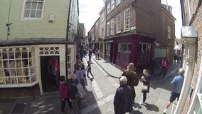 YORK, ENGLAND, JUNE 22 2015: visitors walking along old, historical streets. enjoying summer holidays stock video