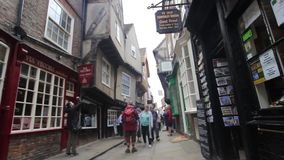 YORK, ENGLAND, JUNE 22, 2015: visitors walking along old streets. Visitors walking along old streets of York, England stock video footage