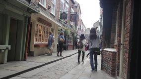 YORK, ENGLAND, JUNE 22, 2015: visitors walking along old streets. Of the old historical places stock footage