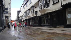 YORK, ENGLAND, JUNE 22, 2015: visitors walking along old streets. In the old places stock video footage