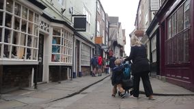 YORK, ENGLAND, JUNE 22, 2015: visitors walking along old streets. In the old places stock video