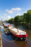 York England River Ouse looking to Skeldergate Bridge with barge Stock Photo