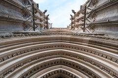 York England UK. View of the entrance to York Minster, looking up towards the sky. Photo shows details of the stone carvings. Photographed on a sunny summer stock images