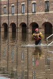 York Floods - Sept.2012 - UK. Rescue worker - The River Ouse floods the streets of central York in the United Kingdom.  September 2012 Royalty Free Stock Images