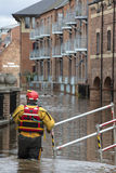 York Floods - Sept.2012 - UK. A rescue worker walks along a flooded road as the River Ouse bursts it's banks and floods the streets and properties of central Royalty Free Stock Photos