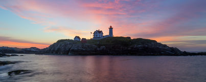 York, Maine - Nubble Light sunrise silhouette. This is a sunrise at the Nubble Lighthouse in York, Maine.  The area is also called Cape Neddick Royalty Free Stock Photos