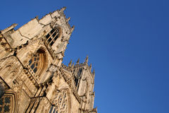 York Minster Cathedral. The imposing frontage of York Minster Cathedral in York, England against a vivid blue sky royalty free stock images