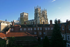 York Minster cathedral, York, England. York Minster cathedral rising above houses in York city centre Stock Photos