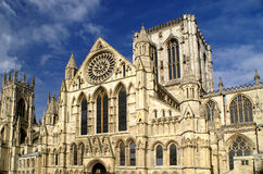 York Minster Catherdral. Stone architecture of the historic York Minster in UK bathed in early morning sunshine with a polarised deep blue sky Stock Images
