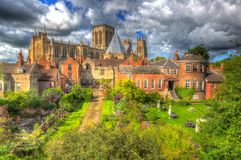 York Minster rear view from the City Walls of the historic cathedral tourist attraction in colourful hdr. York Minster rear view from the City Walls of the Stock Photo