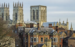 York Minster spires with red brick buildings in the foreground Royalty Free Stock Photo