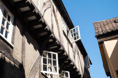 York shambles, old fashioned windows on medieval street Stock Images