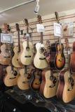 Classic and acoustic guitars. YORK, UK - CIRCA AUGUST 2015: classic and acoustic guitars for sale Royalty Free Stock Photo