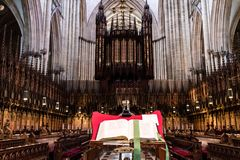 York, United Kingdom - 02/08/2018: Inside York Minster. York, United Kingdom - 02/08/2018: The Bible  behind the pipe organs in York Minster Royalty Free Stock Images