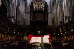 York, United Kingdom - 02/08/2018: Inside York Minster. York, United Kingdom - 02/08/2018: The Bible behind the pipe organs in York Minster stock image