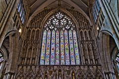 York, United Kingdom - 02/08/2018: Inside York Minster. York, United Kingdom - 02/08/2018: The large stained glass window in York Minster Royalty Free Stock Images