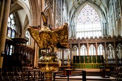 York, United Kingdom - 02/08/2018: Inside York Minster. York, United Kingdom - 02/08/2018: A lectern in the Minster shaped like a golden eagle Stock Images