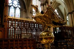 York, United Kingdom - 02/08/2018: Inside York Minster. York, United Kingdom - 02/08/2018: A lectern in the Minster shaped like a golden eagle royalty free stock image