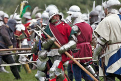 Yorkist charge. TEWKESBURY, UK - JULY 14: Re-enactors of the Battle of Tewkesbury, fought during the Wars of the Roses, lead the Yorkist charge towards the Royalty Free Stock Photo