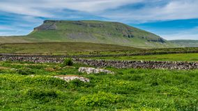Pen-y-ghent, North Yorkshire, England, UK. Yorkshire Dales landscape between Halton Gill and Horton in Ribblesdale with the Pen-Y-Ghent in the background, North royalty free stock photo