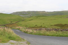 Yorkshire Dales Scenic view. A view into the bright green hills of the Yorkshire Dales with a dry stone wall in the foreground Stock Image