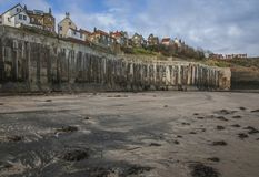 Yorkshire, England, Robin Hood`s Bay - a sandy beach and some houses.. The image shows a view of a sandy beach in Robin Hood`s Bay - a village in Yorkshire. We royalty free stock image