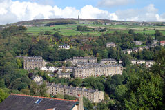 Yorkshire hillside village. Old Yorkshire hillside village with farms and mills stock image