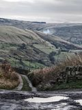 Yorkshire moorland in winter lane and stone walls. Yorkshire moorland in winter with small lane and stone walls stock photos