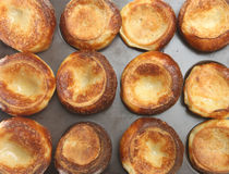Yorkshire Puddings. Freshly baked Yorkshire puddings on a baking tray Stock Photography