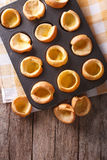 Yorkshire puddings in baking dish on the table. vertical top vie Royalty Free Stock Photo