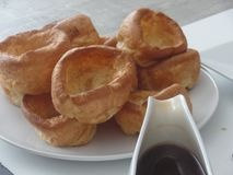 Yorkshire puddings served with gravy royalty free stock images