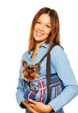 Yorkshire Terrier in dog's carrying bag with woman Royalty Free Stock Photo