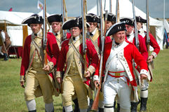 Yorktown British Army. Northampton, UK, JULY 17, 2011: Soldiers of the British Army in uniform to reenact the American Siege of Yorktown in the 18th century stock image