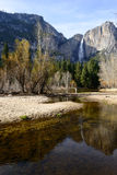 Yosemite Fall and reflection in a river Stock Images