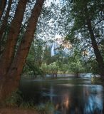 Yosemite falls from the flooded banks of the Merced River royalty free stock photography