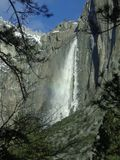 Yosemite Falls. The waterfall turns to snow as it falls and is blown to the side by the wind Royalty Free Stock Photography