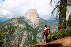 Yosemite Hiker. Hiker in Yosmite National Park looking at El Capitan mountain royalty free stock photography