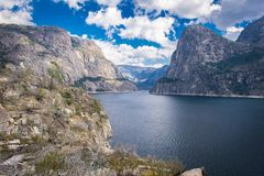 Yosemite Mountains at Hetch Hetchy. This amazing view can be seen through the trail in Hetch Hetchy by Yosemite California Stock Photo