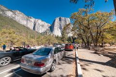 View to El Capitan rock in Yosemite from the road underneath. Tourists cars in Yosemite national Park Stock Photos