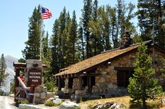 Yosemite National Park entrance. Yosemite National Park (California's Sierra Nevada mountains) - Entrance of the park, with sign and United States flag Royalty Free Stock Photography